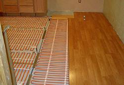 Теплый пол под ламинат делает напольное покрытие еще комфортнее