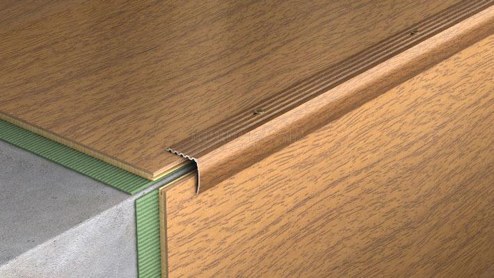 Угловой вариант порожка применяется при необходимости осуществить фиксацию краевой части напольного покрытия на участке рядом со ступенями