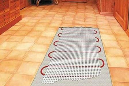 Принцип действия электрического пола с подогревом – нагревание резистивного кабеля при прохождении тока